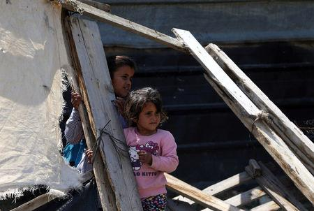 Palestinian girls look on after their family structure was demolished by Israeli forces near the West Bank city of Jericho April 7, 2016. REUTERS/Mohamad Torokman
