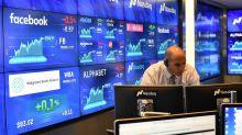 MARKETS: Nasdaq notches another record, financials struggle, media names surge on merger mania
