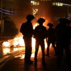 Scores injured in Jerusalem clashes; Israeli nationalists shout 'Death to Arabs""
