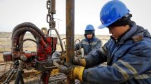 U.S. oil slips on demand worries; but global crude buoyed by Mideast tensions