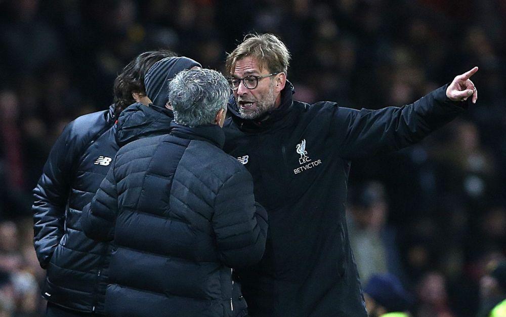 Jurgen Klopp raises a point of order with Jose Mourinho - EPA