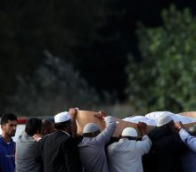 New Zealand begins funerals for mosque shooting victims, PM visits school