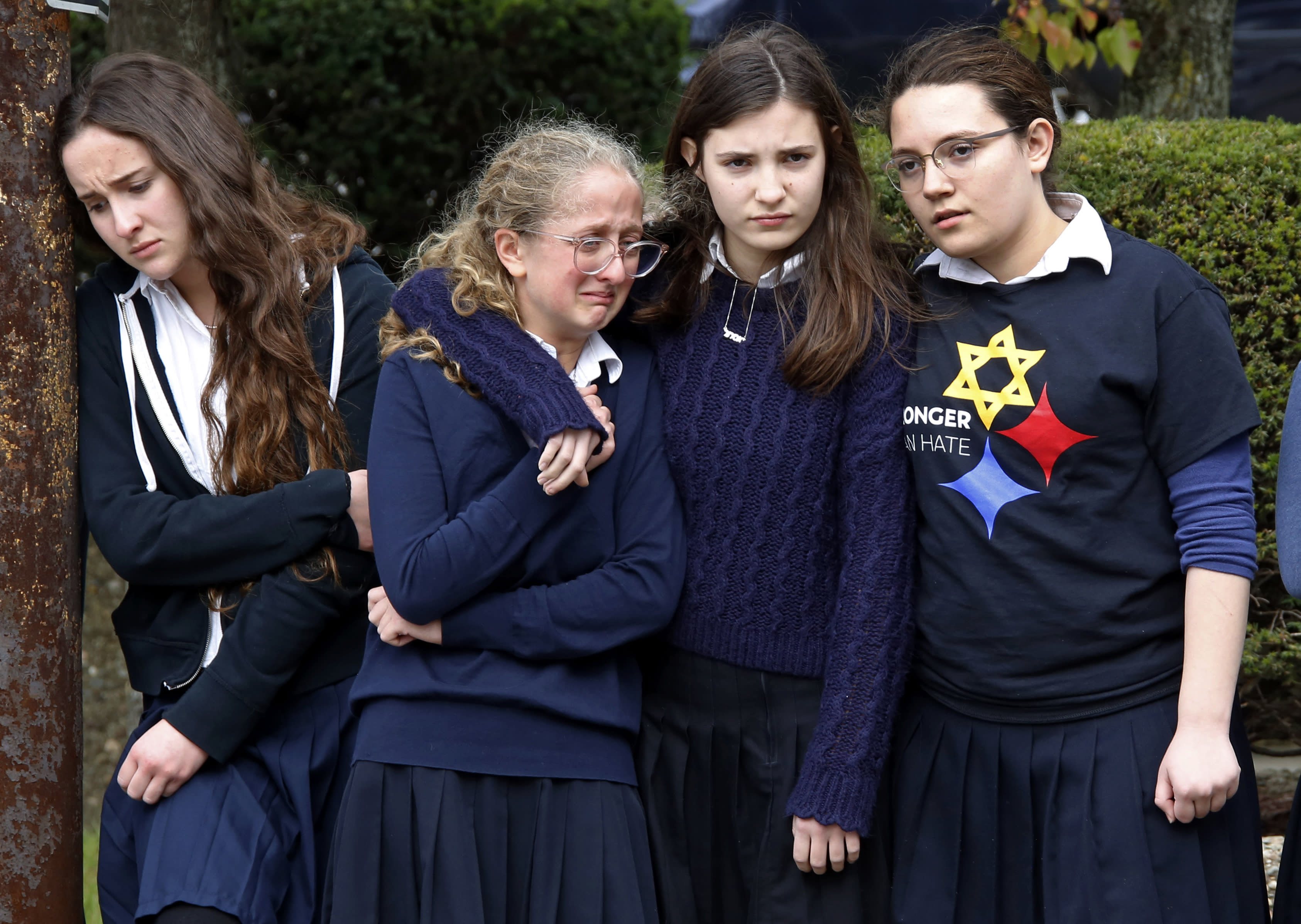 <p>Students from the Yeshiva School in the Squirrel Hill neighborhood of Pittsburgh, pay their respects as the funeral procession for Dr. Jerry Rabinowitz passes their school en route to Homewood Cemetery following a funeral service at the Jewish Community Center, Tuesday Oct. 30, 2018. Rabinowitz was one of people killed while worshipping at the Tree of Life synagogue on Saturday, Oct. 27, 2018. (Photo: Gene J. Puskar/AP) </p>