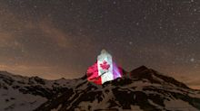 Matterhorn lights up with flags from around the world