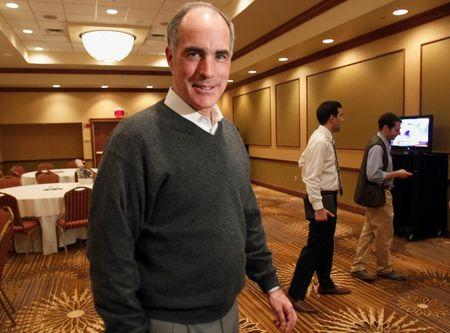 U.S. Senator Casey smiles after making remarks to reporters at the Hilton Conference Center in Scranton