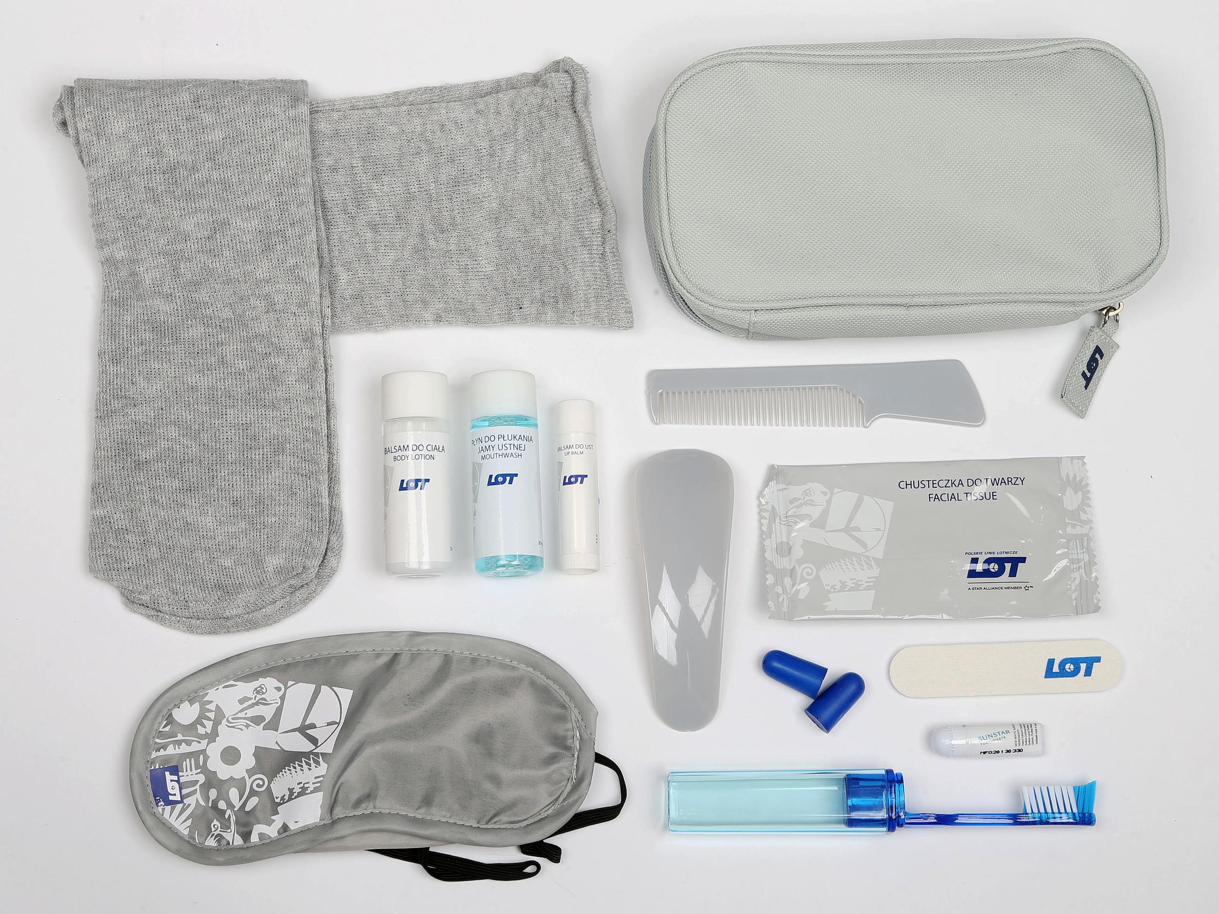 <p><strong>What do you get?</strong> The Business Class kit contains a range of cosmetics: Socks, eye mask, shoe horn, ear plugs, mouthwash, body lotion, lip balm, wet wipe, nail file, comb<br /> <strong>Best bit of the kit?</strong> The attention to detail is striking: all of the products are decorated not only with LOT's logo but also a quirky little white design on a light grey background; there is a nice feel to the soft grey socks too.</p>