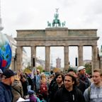 Germany unveils €54bn climate plan as thousands in Berlin join global strike