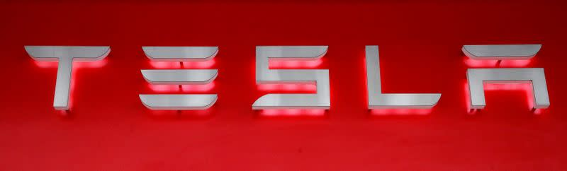 FILE PHOTO: Company logo is seen in front of a showroom of U.S. car manufacturer Tesla in Zurich