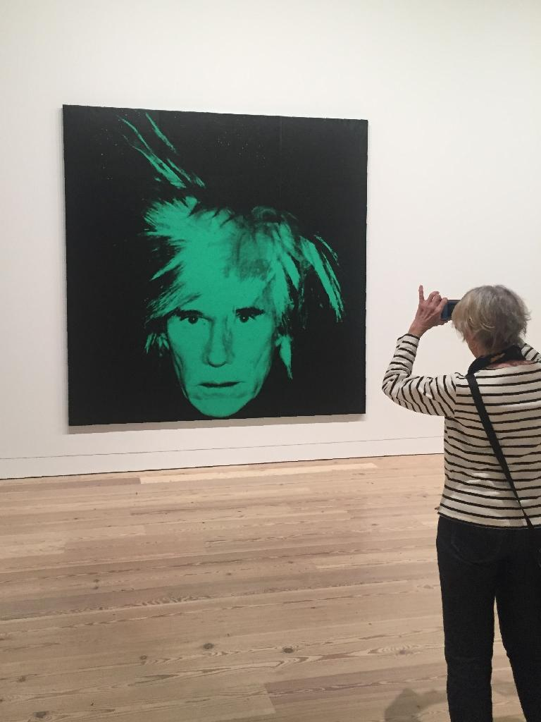 """Andy Warhol self-portrait at a preview of """"Andy Warhol -- From A to B and Back Again"""" at New York's Whitney Museum (AFP Photo/Thomas URBAIN)"""
