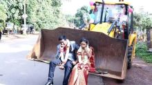 #Unconventional: Post wedding, bride and groom drive off in a JCB Earthmover