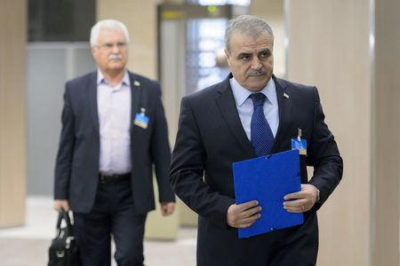 Members of the Syrian opposition delegation of the HNC arrive for a meeting in Geneva