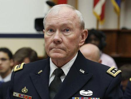Chairman of the Joint Chiefs Dempsey listens to a question during the House Armed Services Committee on Capitol Hill in Washington