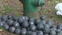 Watch stunned motorists dodge metal balls rolling down Seattle street