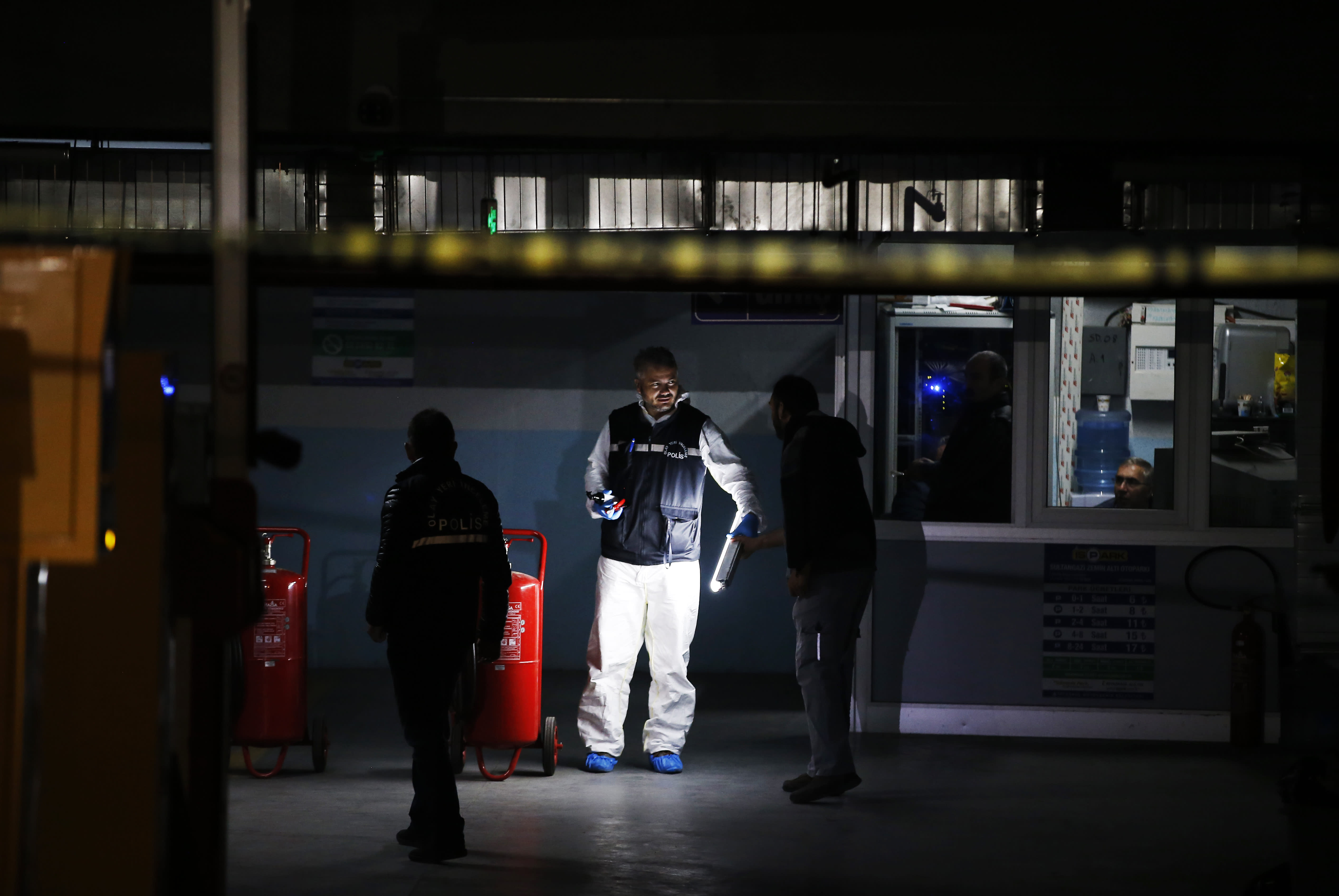 Turkish police crime scene investigators, looking for possible clues into the killing of Saudi journalist Jamal Khashoggi, work in an underground car park, where authorities Monday found a vehicle belonging to the Saudi consulate, in Istanbul, Tuesday, Oct. 23, 2018. Saudi officials murdered Khashoggi in their Istanbul consulate after plotting his death for days, Turkey's President Recep Tayyip Erdogan said Tuesday, contradicting Saudi Arabia's explanation that the writer was accidentally killed. (AP Photo/Emrah Gurel)