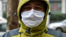 China stiffens defences against epidemic as death toll hits 56