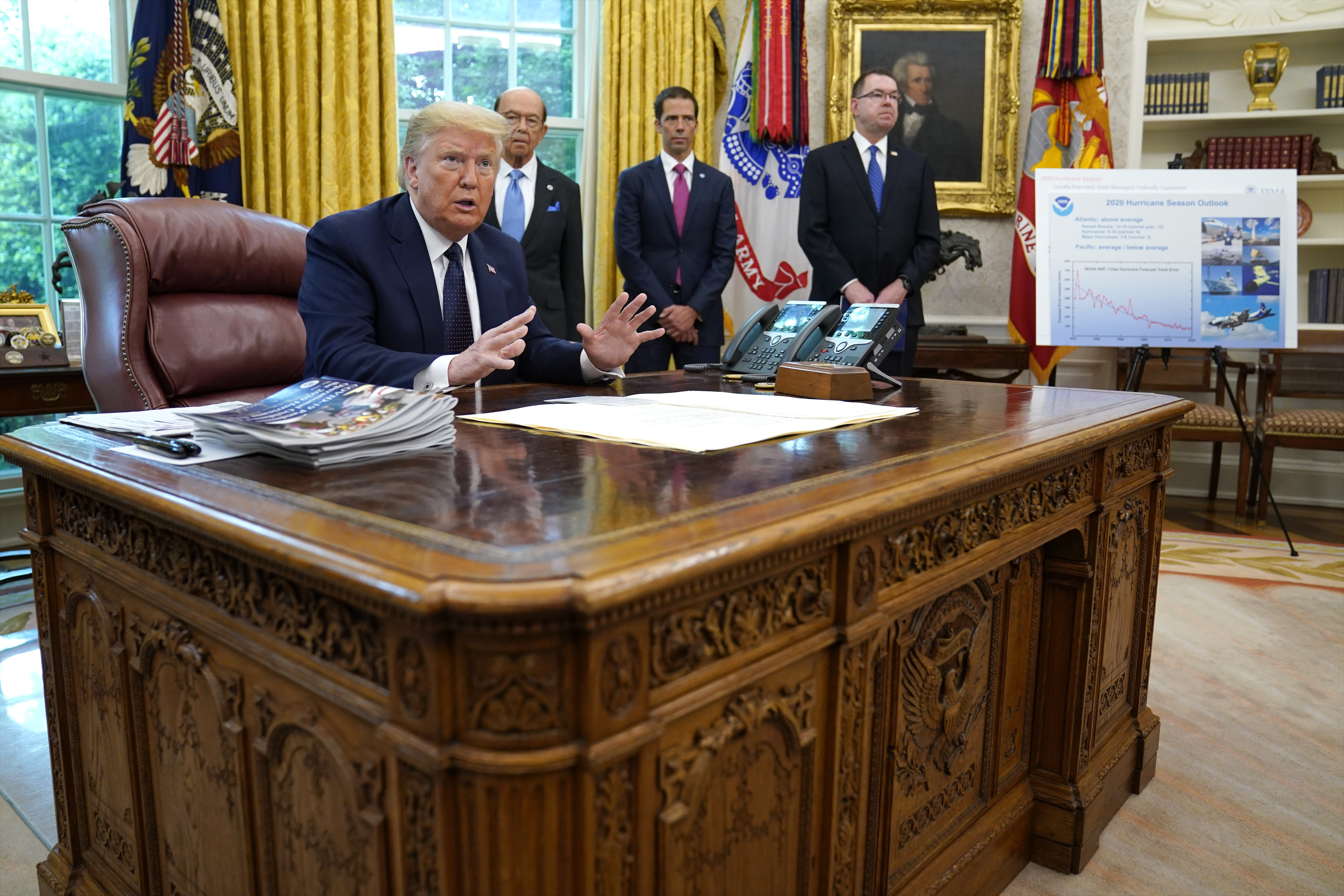 President Donald Trump speaks as he receives a briefing on the 2020 hurricane season in the Oval Office of the White House, Thursday, May 28, 2020, in Washington. Watching are Commerce Secretary Wilbur Ross and Neil Jacobs, assistant Secretary of Commerce for Environmental Observation and Prediction, and Pete Gaynor, administrator of the Federal Emergency Management Agency. (AP Photo/Evan Vucci)