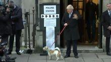 UK PM Johnson brings four-legged friend to cast vote