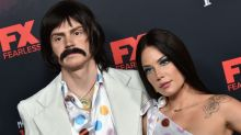 Rockin' the red carpet: Halsey and Evan Peters step out with music-inspired costumes
