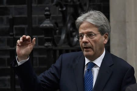 Italy's Prime Minister Paolo Gentiloni waves as he leaves after meeting his counterpart from Britain Theresa May at Number 10 Downing Street in London