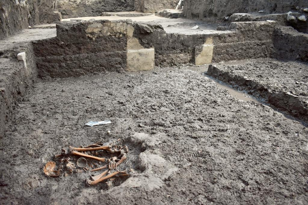 Human remains lie in what Mexican archeologists say was a dwelling area in today's downtown Mexico City for upper class Aztecs who survived the Spanish conquest