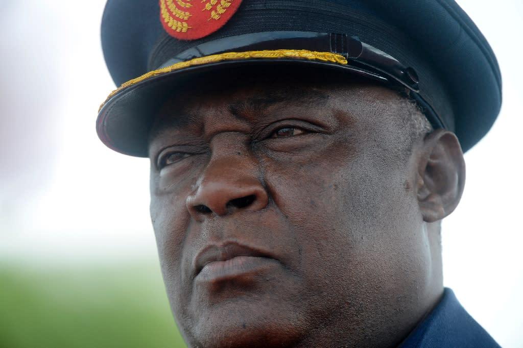 Nigeria's ex-defence chief raided staff salary funds