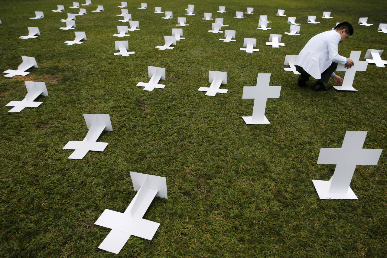 <p>A protester sets up paper grave markers during a protest against the visit of Zhang Dejiang, chairman of China's National People's Congress, to Hong Kong on May 17, 2016. Hong Kong authorities rolled out a massive security operation on Tuesday as they braced for protests during a top Beijing official's visit to the semiautonomous city, which has been the scene of rising discontent with Chinese rule. (Vincent Yu/AP)</p>