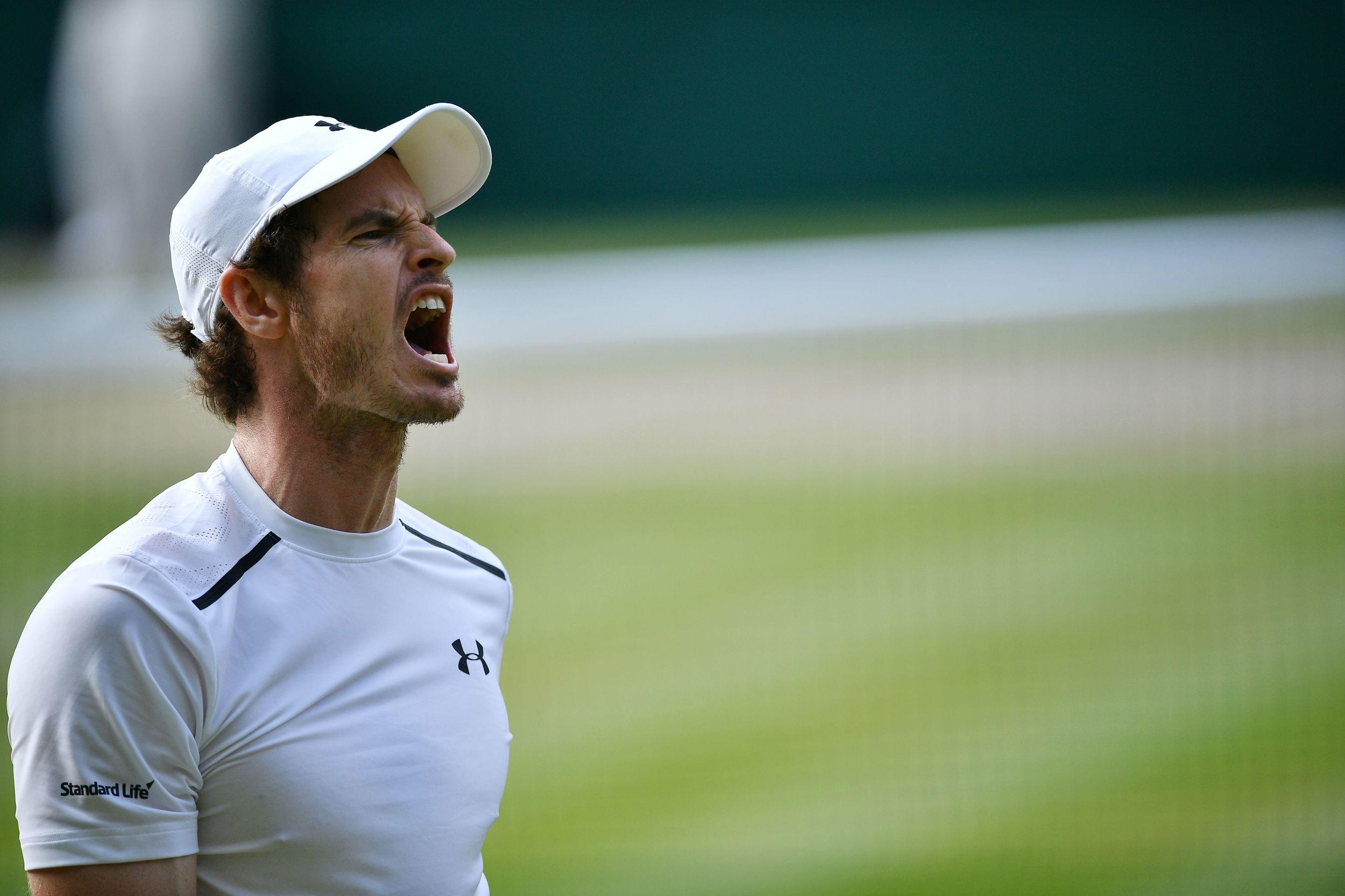 Britain's Andy Murray roars after winning a point.