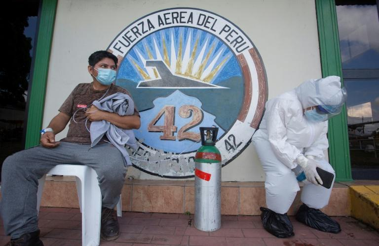 Peru has restarted domestic air and bus travel under strict sanitation measures such as the wearing of face masks and temperature checks (AFP Photo/César Von Bancels)