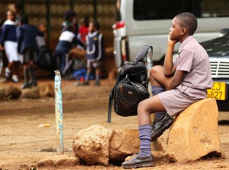 Zimbabwean schoolchild awaits transport from school during a teachers' strike in Harare, Zimbabwe, February 8, 2019. REUTERS/Philimon Bulawayo