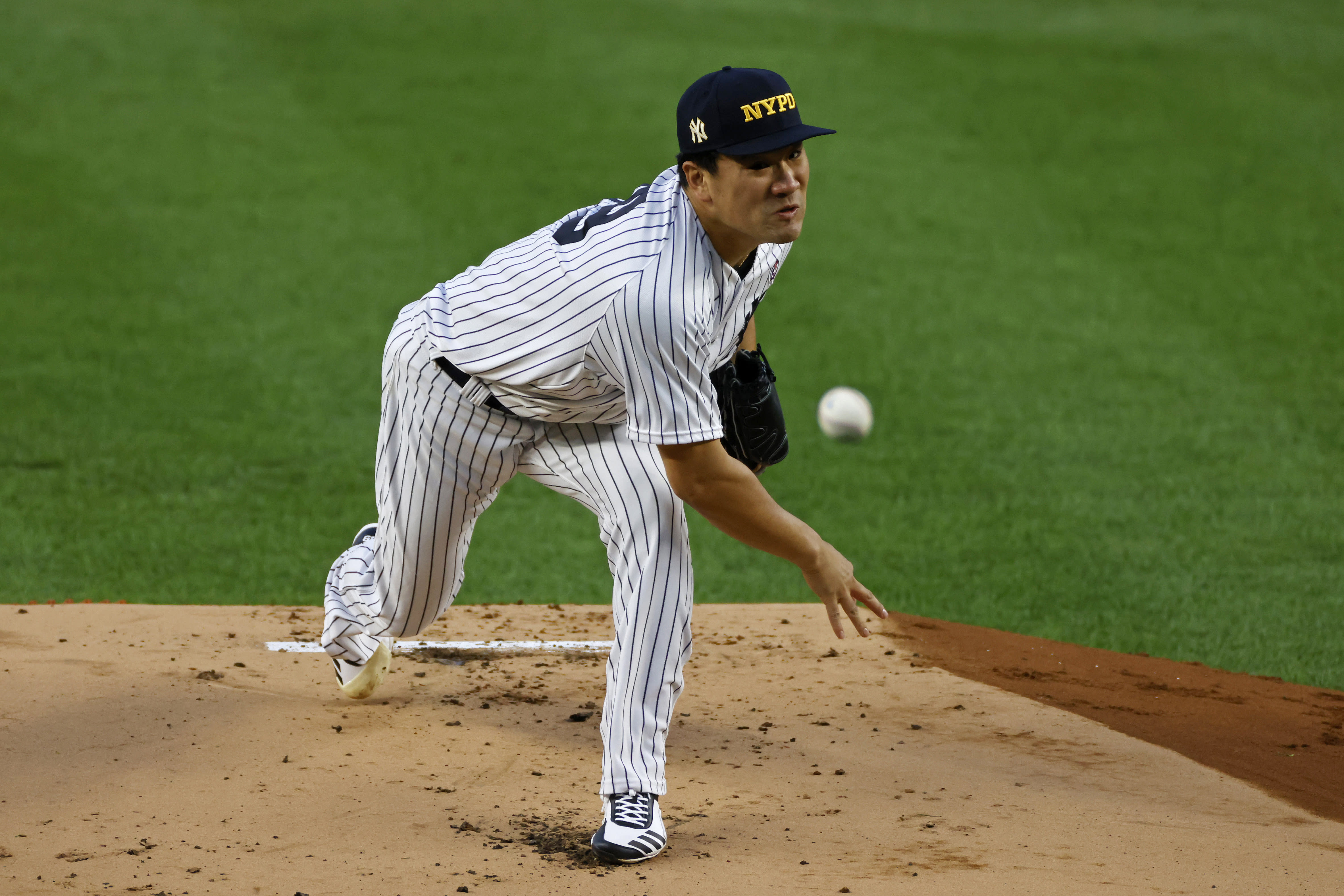 New York Yankees pitcher Masahiro Tanaka throws during the first inning of the second baseball game of the team's doubleheader against the Baltimore Orioles, Friday, Sept. 11, 2020, in New York. (AP Photo/Adam Hunger)