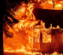'Like a hammer hitting us in the head': Homes ablaze in California as Western wildfires rage