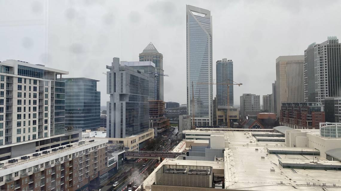 Live video replay: Snow falling in uptown Charlotte ahead of the evening commute