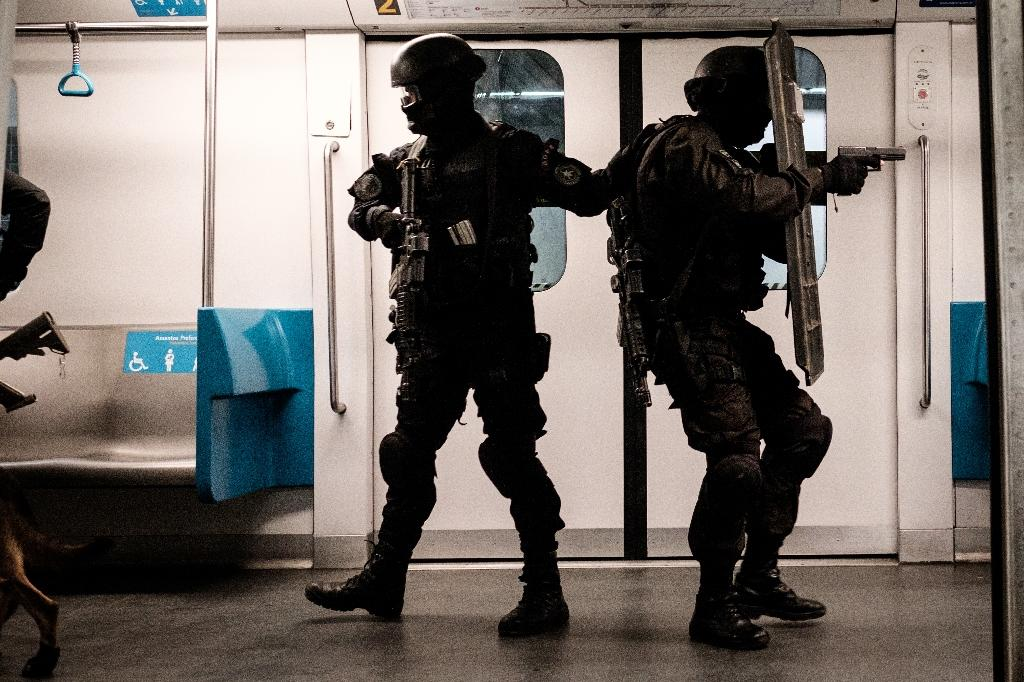 Security has become a major concern in the Olympics run-up, with authorities drafting in soldiers and extra police to build up an security force of 85,000 people (AFP Photo/Yasuyoshi Chiba)
