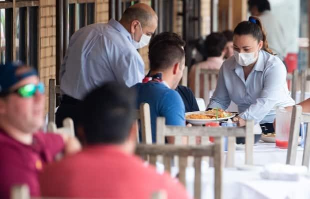 The province announced on Monday that all food and liquor-serving premises must pivot to takeout or delivery service. Indoor dining is suspended, though patios will remain open. (Saul Loeb/AFP via Getty Images - image credit)