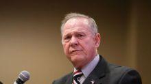 Trump defends Senate candidate Moore despite misconduct allegations