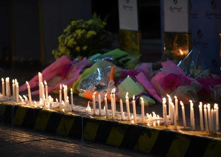 FILE PHOTO: Lighted candles and flowers are pictured outside Resorts World during a memorial for those killed in a casino fire caused by a gunman in Pasay City, Metro Manila Philippines June 2, 2017. REUTERS/Dondi Tawatao