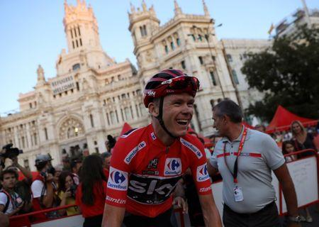 Team Sky rider Froome of Britain reacts at the end of the last stage of the La Vuelta Tour of Spain cycling race in Madrid