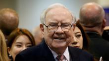 Berkshire says median employee makes over half Buffett's pay