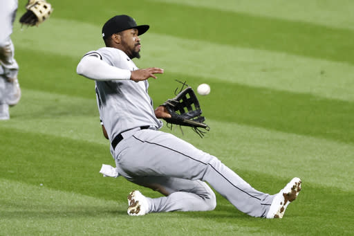 Chicago White Sox's Eloy Jimnez makes a sliding catch to get out Cleveland Indians' Tyler Naquin during the seventh inning of a baseball game, Monday, Sept. 21, 2020, in Cleveland. (AP Photo/Ron Schwane)