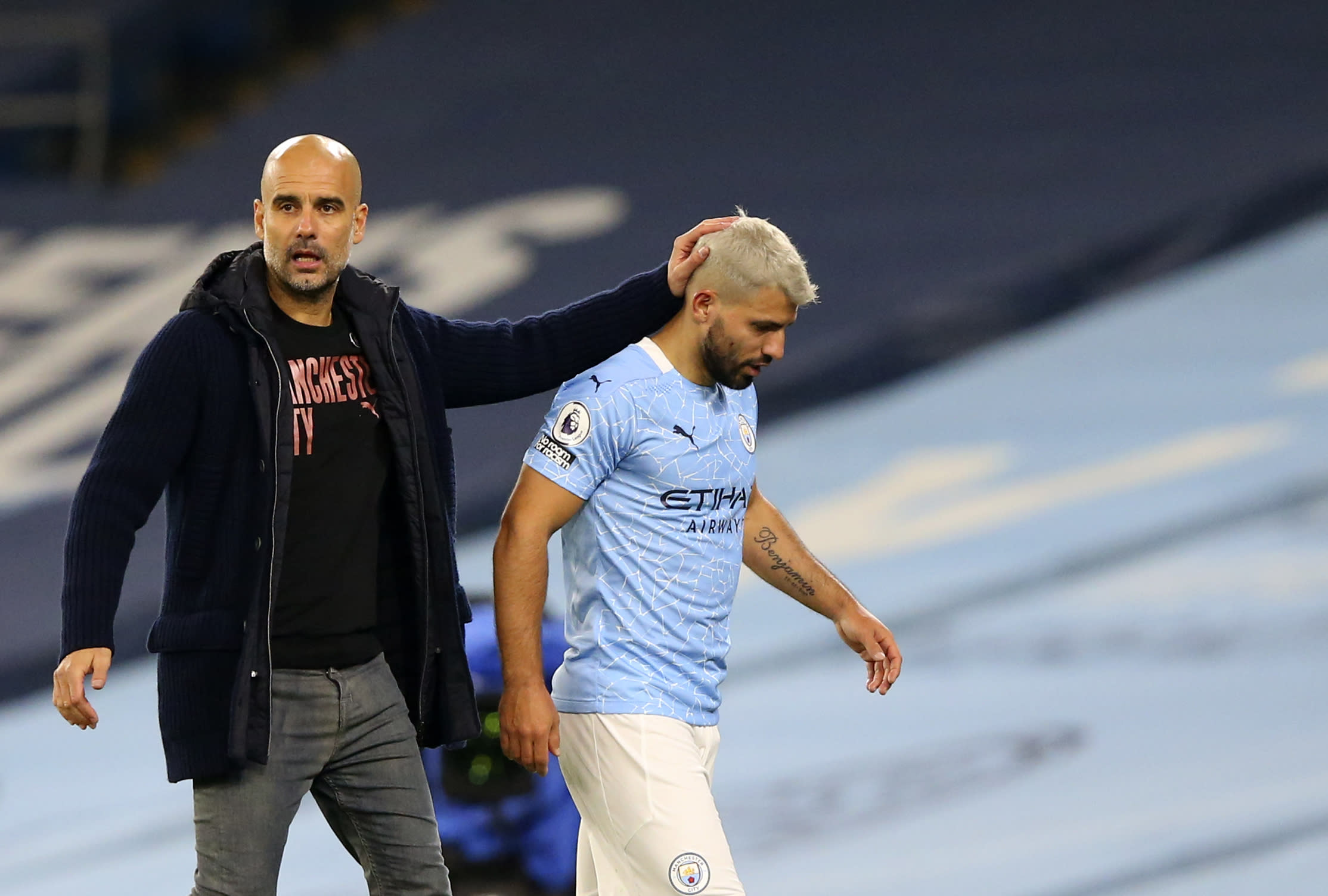 Manchester City's Sergio Aguero passes by Manchester City's head coach Pep Guardiola after being substituted during the English Premier League soccer match between Manchester City and Arsenal at the Etihad stadium in Manchester, England, Saturday, Oct. 17, 2020. (Alex Livesey/Pool via AP)