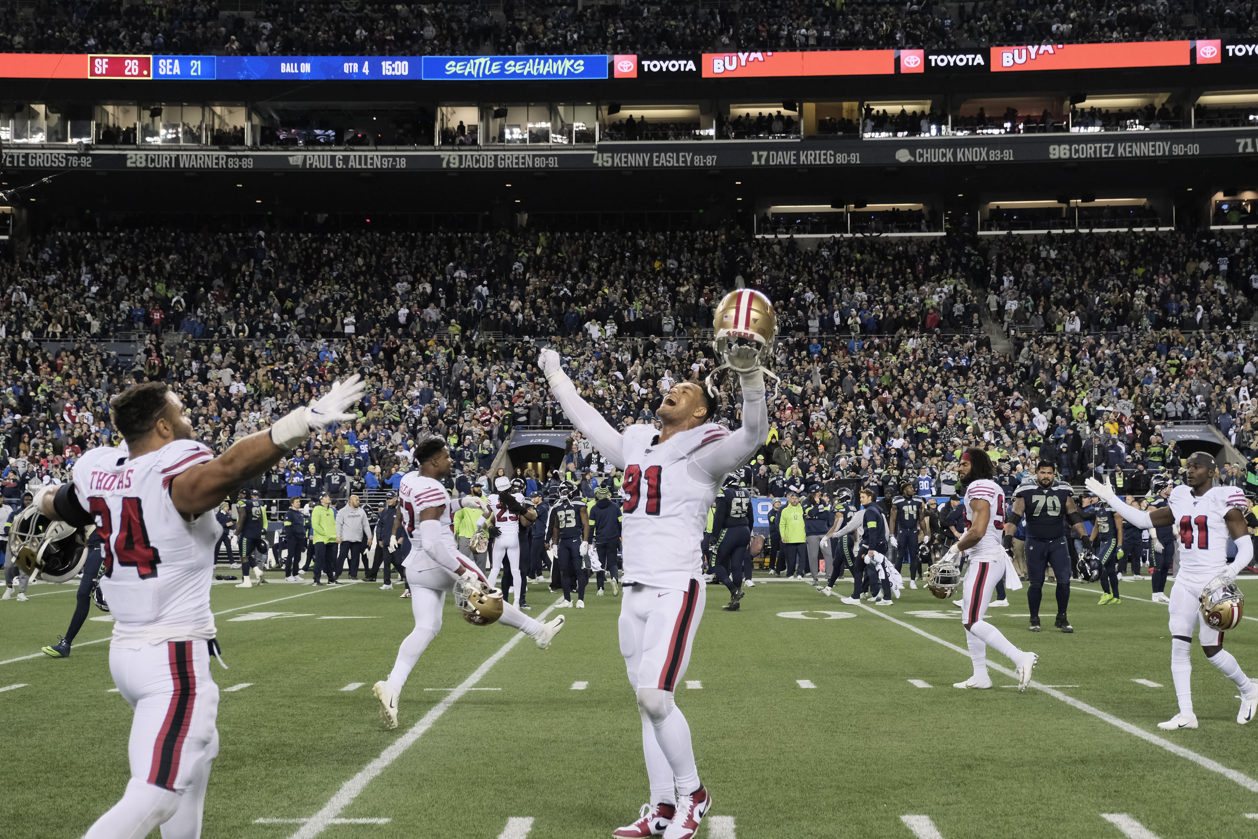 San Francisco 49ers' Arik Armstead (91) raises his arms in celebration as time expires in the team's victory over the Seattle Seahawks in an NFL football game, Sunday, Dec. 29, 2019, in Seattle. The 49ers won 26-21. (AP Photo/Stephen Brashear)