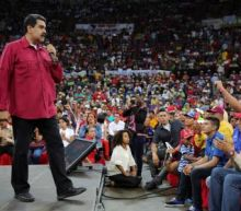 Venezuela president says supporters will take up arms if government falls