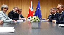 Brexit talks progressing, but issues remain - May