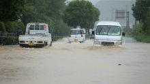 Two feared dead, 13 missing as heavy rain lashes western Japan