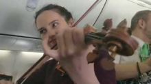 Irish Woman Celebrates Saint Patrick's Day With Fiddle Session on Flight to Dublin