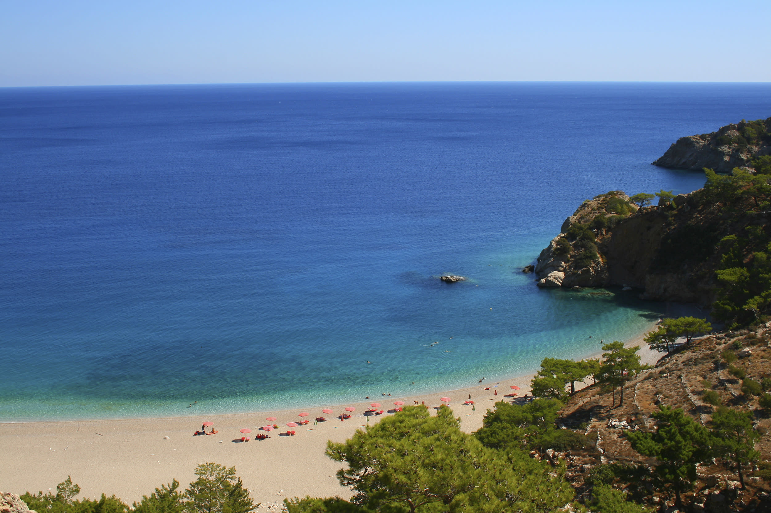 """<p>Karpathos is part of the Dodecanese complex and lies east of <a href=""""http://travel.aol.co.uk/guides/crete/"""" target=""""_blank"""">Crete</a>. It is one of Greece's best-kept secrets, a mountainous island full of fresh water springs, vineyards and pine-tree forests. Karpathos' rock caves are home to Mediterranean monk seals and around the island there are marvellous hiking paths, secluded beaches and pretty villages, such as Othos and Olympos.</p>"""
