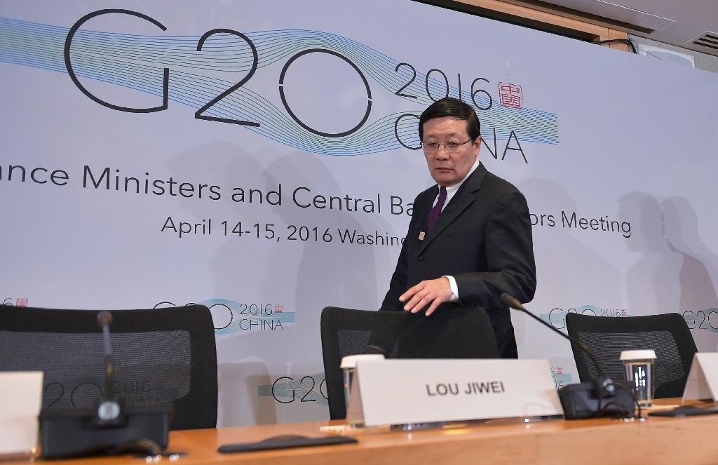 China's Finance Minister Lou Jiwei, chair of the G20, arrives for a press conference after finance chiefs meeting in Washington supported proposals requiring authorities to share the identities of shell companies' real owners (AFP Photo/Mandel Ngan)