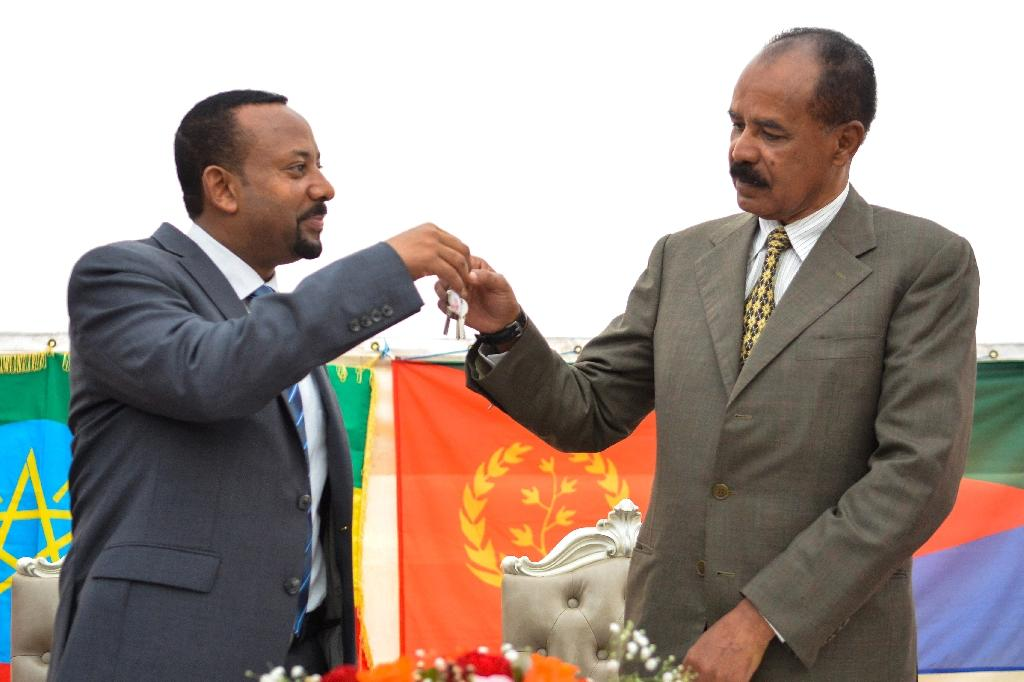 Ethiopian Prime Minister Abiy Ahmed (left) and Eritrean President Isaias Afwerki signed a peace pact in July (AFP Photo/MICHAEL TEWELDE)