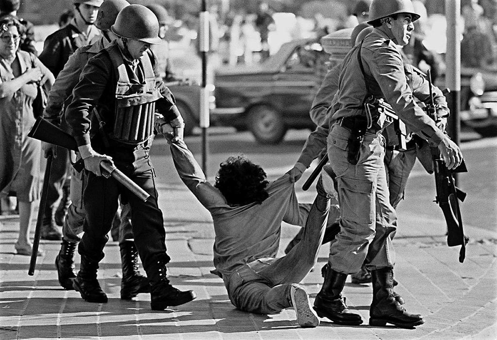 A worker being arrested during a protest against the Argentine dictatorship in Buenos Aires on March 30, 1982 (AFP Photo/Daniel Garcia)