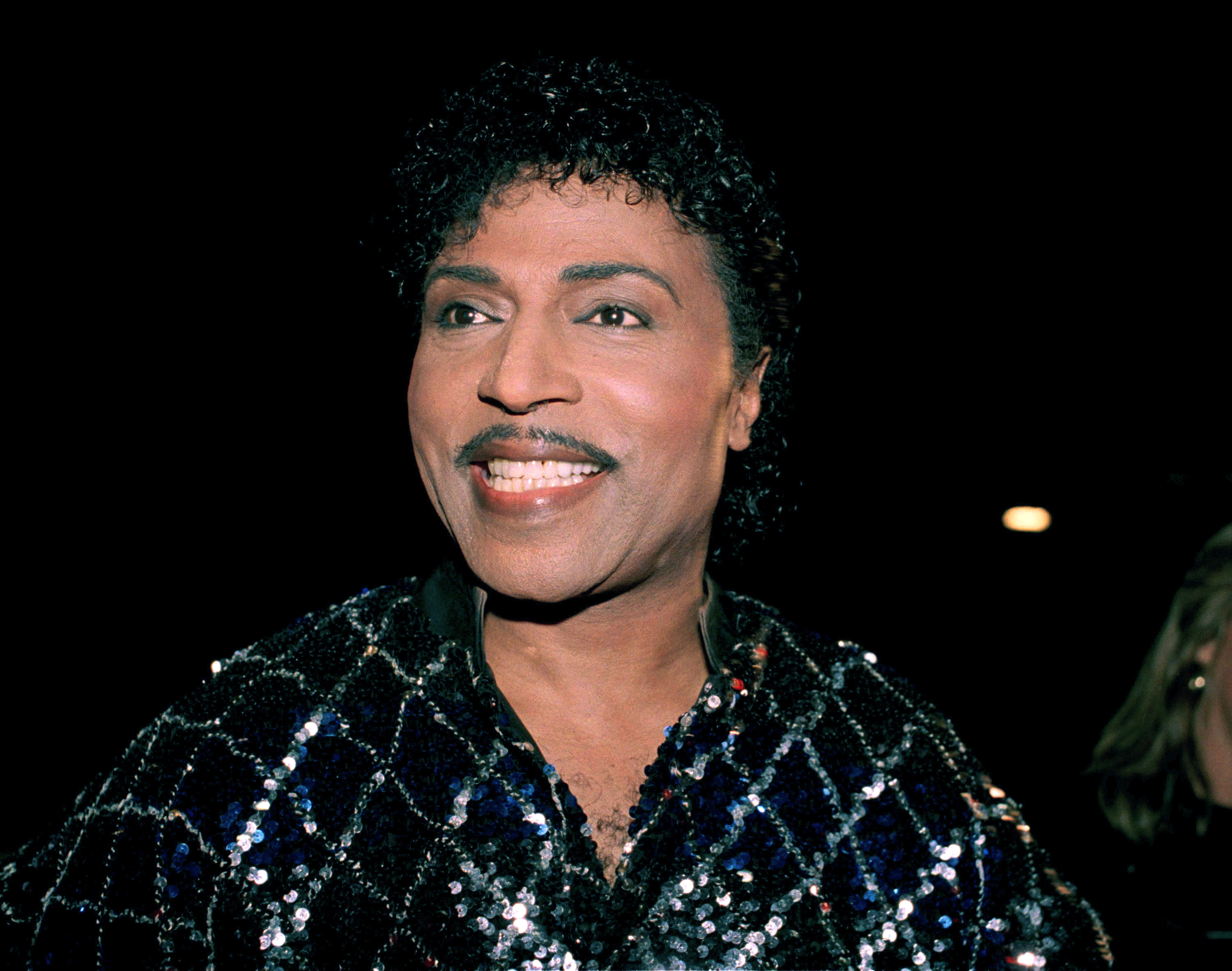 """FILE - This Nov. 13, 1986 photo shows Little Richard in Los Angeles. Little Richard, the self-proclaimed """"architect of rock 'n' roll"""" whose piercing wail, pounding piano and towering pompadour irrevocably altered popular music while introducing black R&B to white America, has died Saturday, May 9, 2020. (AP Photo/Mark Avery, File)"""